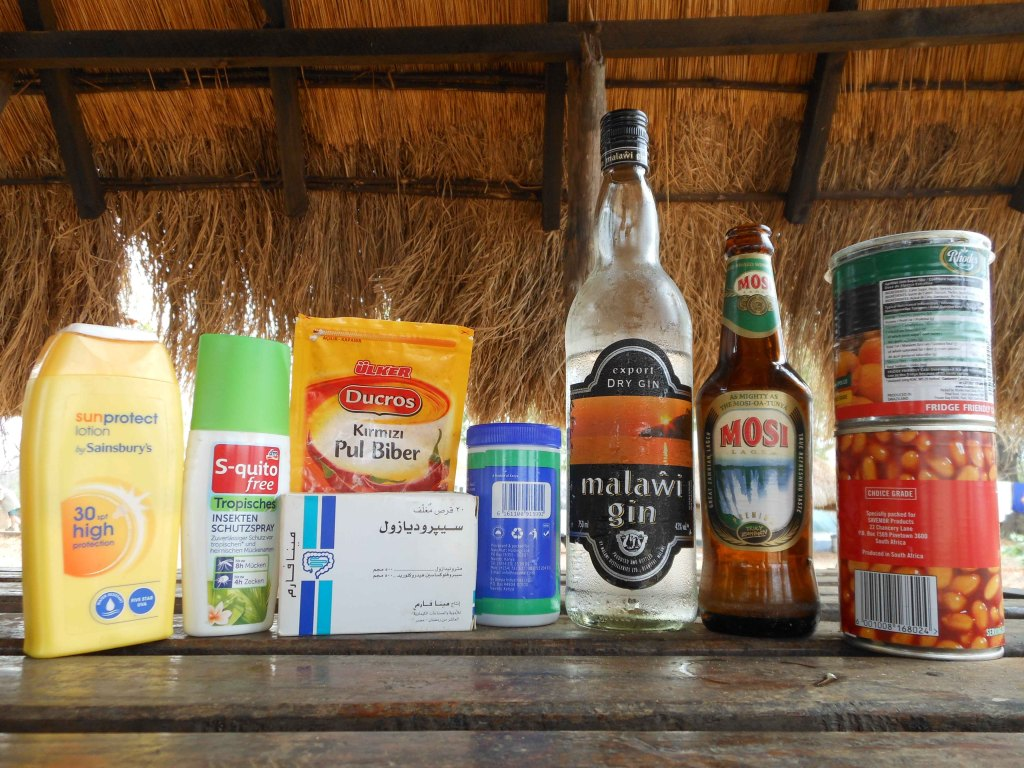 Left to right: UK sunscreen, German insect repellent, Turkish red pepper, Egyptian medicine for parasites, Kenyan herbs, Malawian gin, Zambian beer, South African beans, Swaziland jam